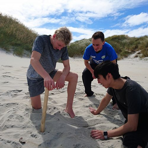 Olie, Harrison and Timmy attempt to measure saltation (sand movement due to wind action) at Sandfly Bay