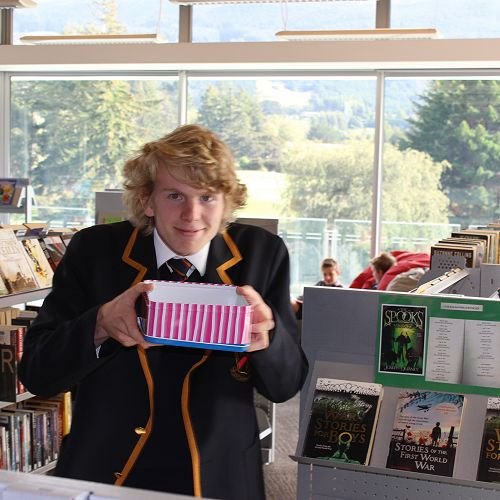 Head Librarian Liam Miller handing out the treats.