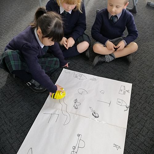 Carson, Tirzah and Grace working out what their code will be.