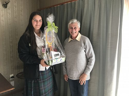 Another lucky PIA raffle winner accepts her prize