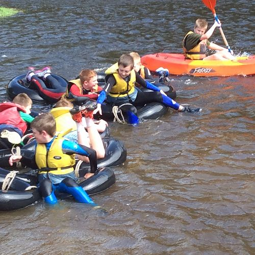 The boys from Balmacewen House on the raft they made.