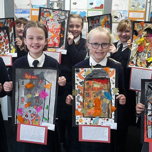 Year 5 students proudly showing their artwork