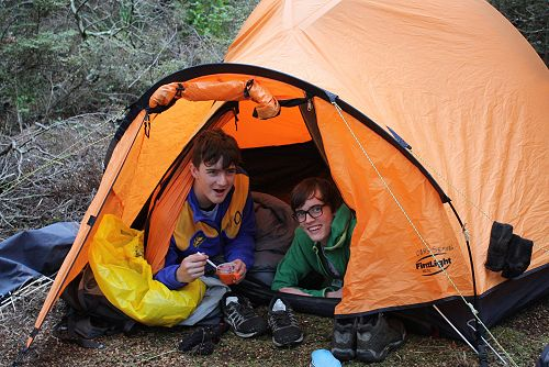 Matthew and George relaxing in their tent