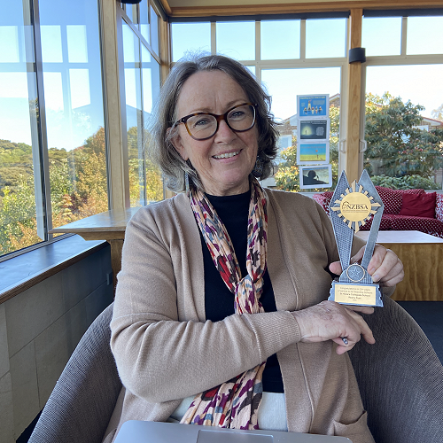 Mrs Rust with her award for 40 years in boarding
