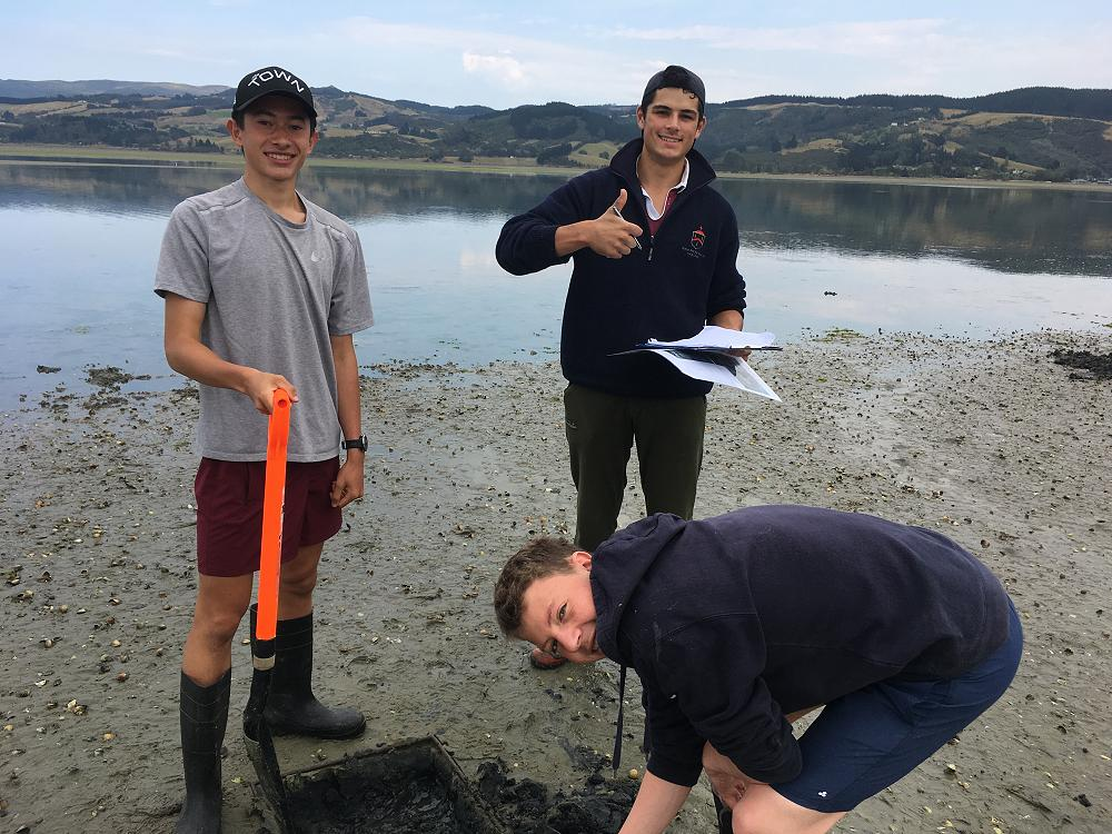 Josh, Angus & Eli sampling the mudflat community