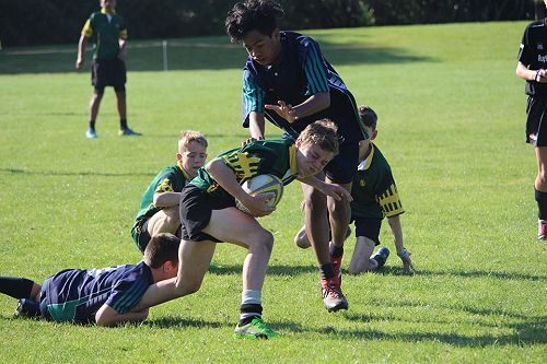 Zach Arundel fighting through the tackle for rugby 7s