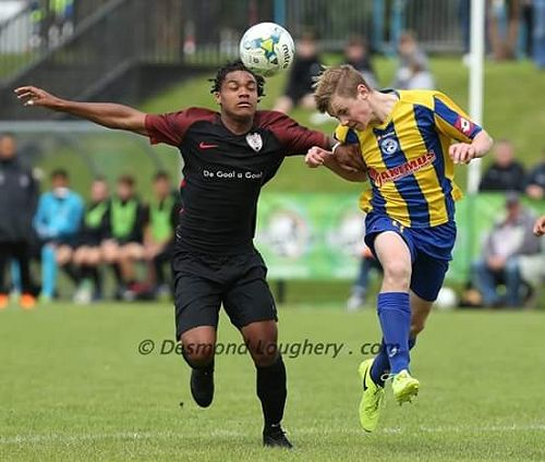 Andrew Cromb Competes for a header in the Super cu