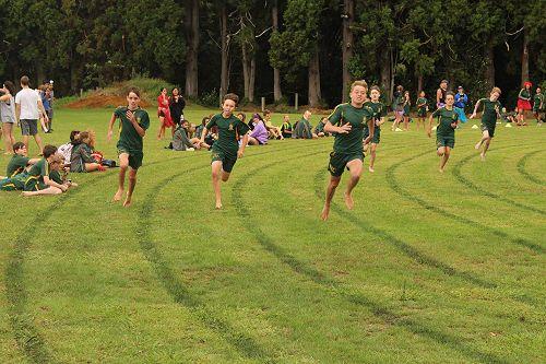 Junior Boys 200m, from left: Eli Brydon, Dawson Salmons, Zach Arundel in front, Jack Tidman, Luke Spurr and Jack Wynne on the bend