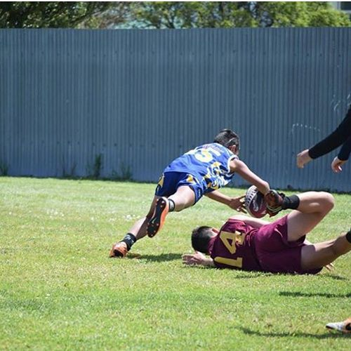 Orlando Tuhega-Vaitupu 7Mbe dives over to score a fantastic try for the Otago touch team.
