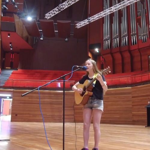 "Olivia performing her song ""Worth"" at the Town Hall"