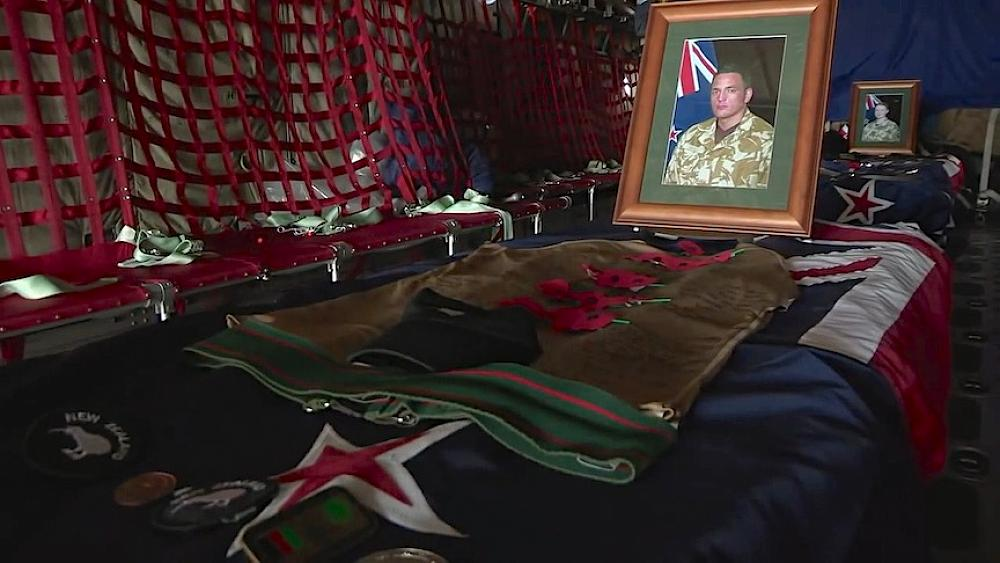Part of the plane's interior on the flight returning the three soldiers remains.