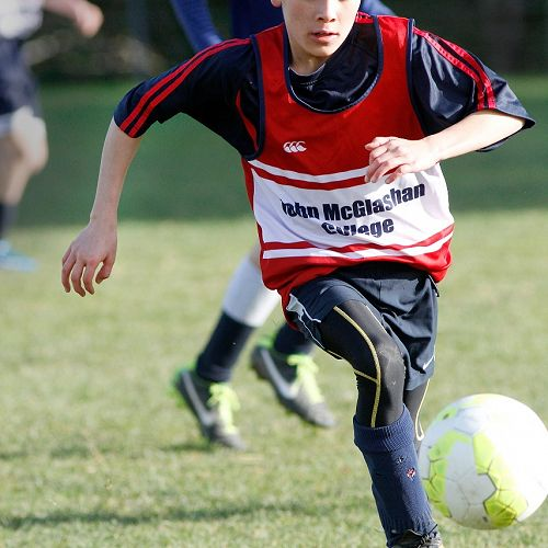 Anton Stoddard runs the ball into space in the Waihi Exchange Football Game