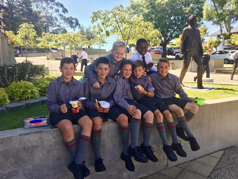 Our young McGlashan men watched over by Bryn Jones' McGlashan Man sculpture