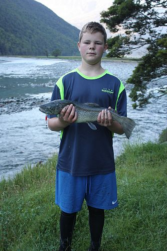 Cody with his brown trout caught on the overnight