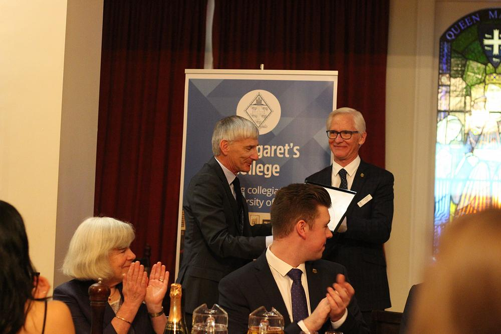 Dr John Heydon (left) receives his Fellow's Certif
