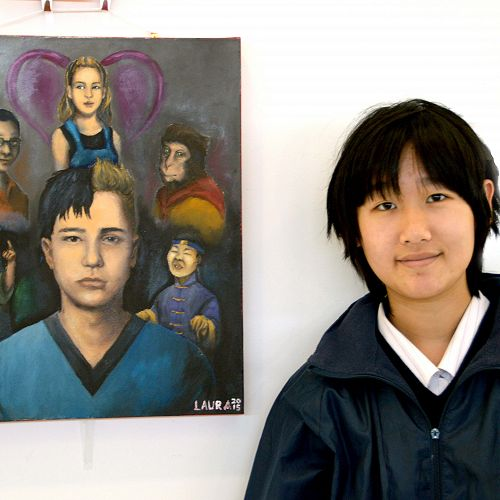 """Laura Wu stands next to her painting that was awarded first-equal place in the """"Every Story Tells a Picture"""" competition."""