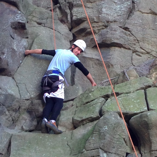 George Gallichan climbing/hopping with shoes tied together!