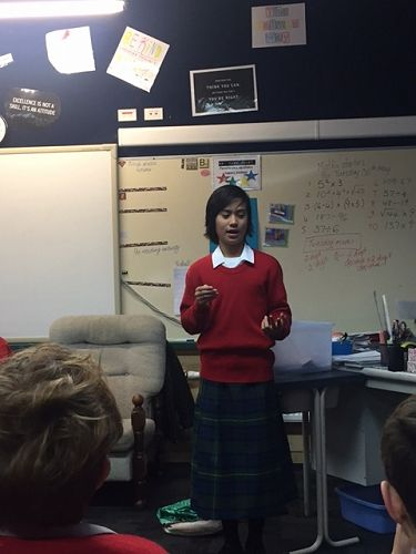 Analeia is giving a presentation for Samoan langua