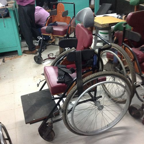 Wheelchairs are custom built in the hospital for cerebral palsy patients.