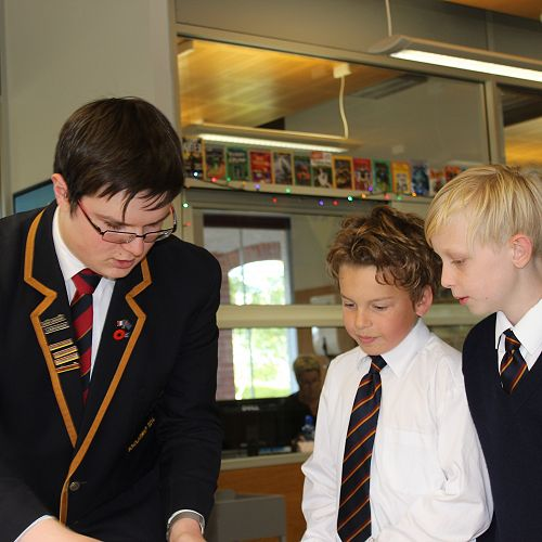 William Archer helps Zachary Smith and James Palmer with their library training.