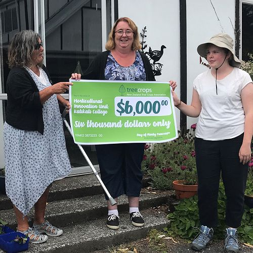 Hilary Johnson and Rose Rayner are presented the cheque by Jeanie Silverthorne