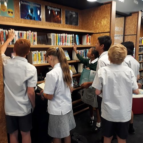 Students choosing books in the LRC