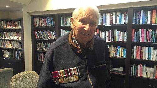 Wattie with his medals