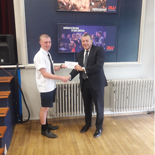 Geoff Cain from the Riccarton Unity Freemasons Lodge presents Liam MacKechnie with his scholarship cheque.