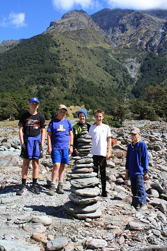 Group 1 pose beside their 10 minute stone tower