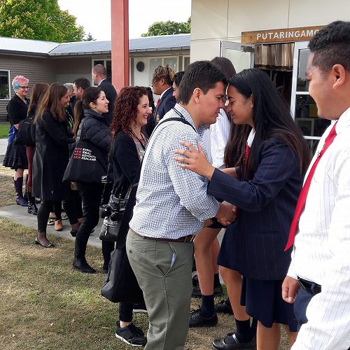 Riccarton High Cultural Leader, Fifita Tahaafe, greets Julian Gonzalez from Colombia.