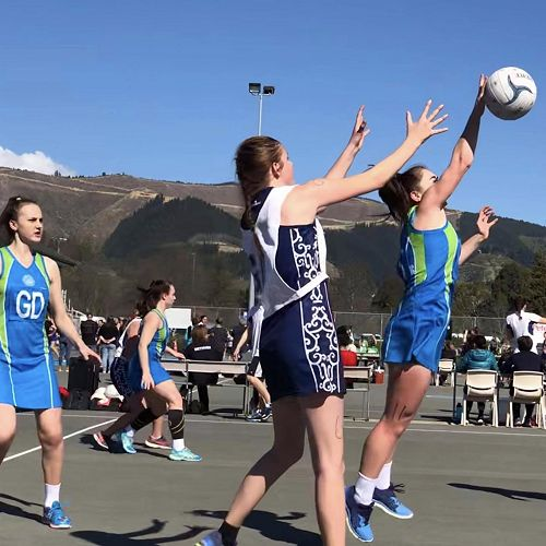 SISS Senior Netball Tournament 2019 - Jenna Williams intercepts as Tyra Jamieson (GD) looks on.