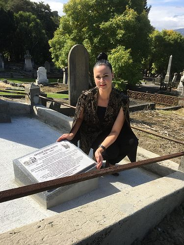 Lisa Breen, Hope and Sons Mosgiel based funeral director with the commemorative plaque at Arthur Burns grave.