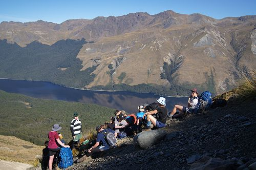 The group pauses for a break during the climb to t