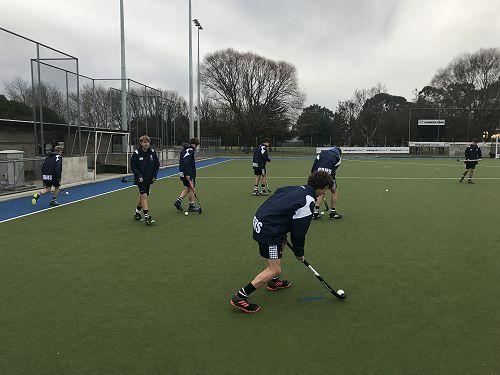 1st XI warming up