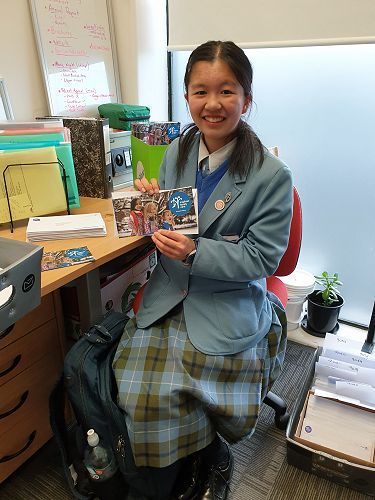 Mayuko helping with our Winter newsletter distribu