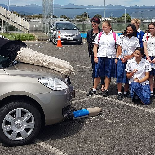 A group of Manawatu College Year 12 students take a look at the impact on a dummy of mis-judging the stopping distance of a car initially travelling at 30 kmph.