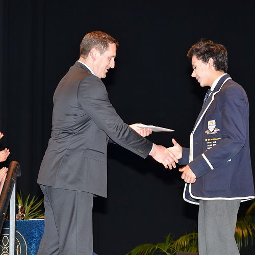 Greg Easton presenting the Stephen Guest Scholarship prize to Shaan Kumar.