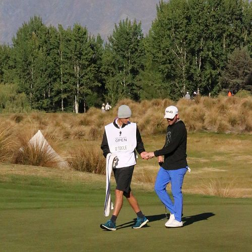 Callum White caddying in the NZ Golf Open