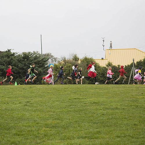 Students running hard and having fun at the 2020 Food Fairy Fun Run event.