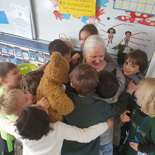 """Mrs Augustine swamped by the Year 1 students on """"Support our Principal"""" day!"""