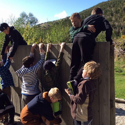 Gilray House work together to get everyone over the wall at the initiative course