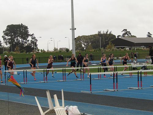 Bethany Oudemans in Lane 6 of Under 15 hurdles