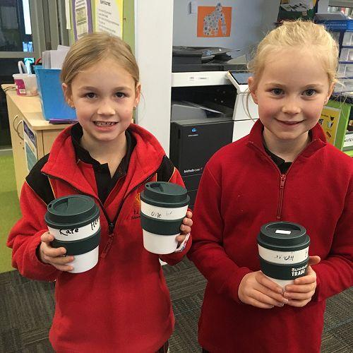 Reusable coffee mugs in use in Orongomai.