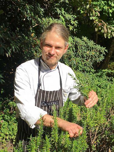 Chef Hannes Bareiter harvesting Rosemary.