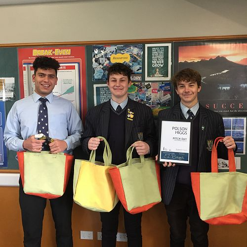 EZ Bags with their product and prize awarded for production potential