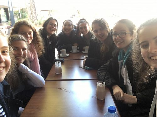 Kiwi girls exploring French café culture.
