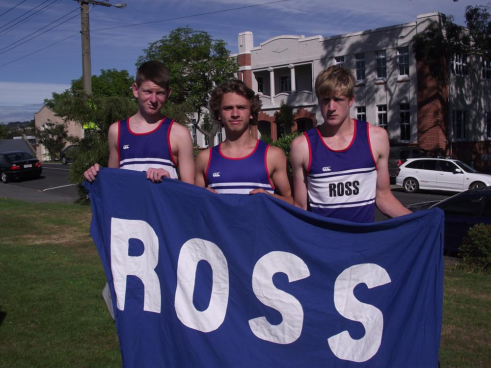 Senior students in Ross house carry the house flag