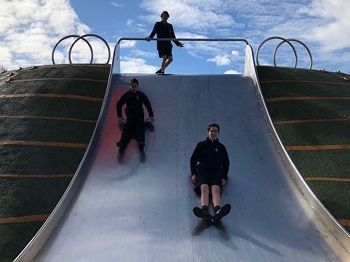 Hayze Natana and Blair Stringer enjoy a slide made for teenagers.