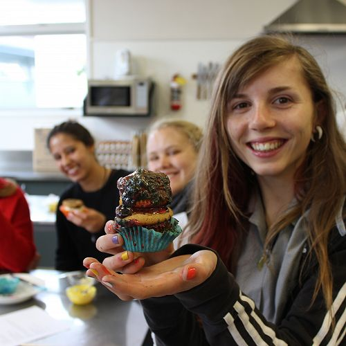 Students embrace the chance to celebrate with cupcakes.