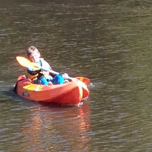 Oscar paddles his kayak back to shore